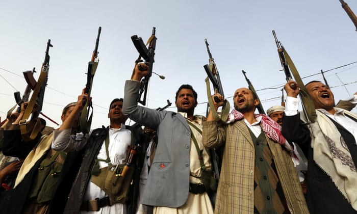 Armed Houthi supporters protest against airstrikes carried out by a Saudi-led coalition in Sana'a, Yemen.