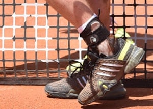 Murray's wedding ring is shown tied through the laces of his trainers during his win over Chardy.