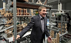 Chris Burden with his kinetic sculpture Metropolis II (2011), which circulates thousands of cars through a network of tracks in a complex model city. Photograph: Jae Hong/AP