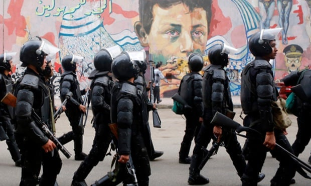 Egypt's riot police head to Tahrir Square in Cairo in November 2014.