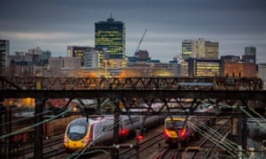 Trains leaving Manchester Piccadilly station.