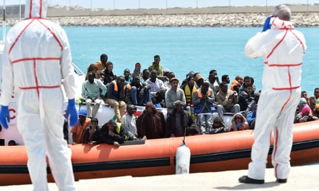 An Italian coastguard ship carrying migrants arrives at Pozzallo's harbor near Ragusa, Sicily on 19 May.
