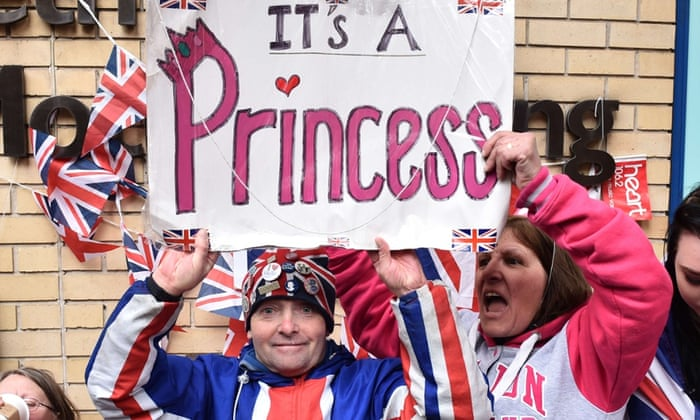Royal fans celebrate the birth of Kate and William's daughter, outside St Mary's hospital in London.