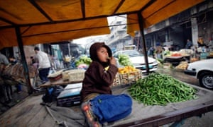 A Palestinian boy waits for customers at a market in Gaza City