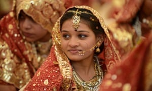 A young Indian Muslim bride during a mass wedding ceremony in Ahmedabad. Marrying girls off at an early age is common in rural areas.