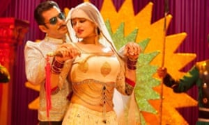 No Merchandising. Editorial Use Only. No Book Cover Usage Mandatory Credit: Photo by Everett/REX Shutterstock (2238032a) DABANGG 2 from left: Salman Khan and Sonakshi Sinha Dabangg 2  - 2012 DABANGG22012FROMLEFTSALMANKHANKAREENAKAPOORSTILLFilm StillsActorFemaleMaleWith OthersPersonality15654722.