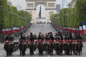 Horsemen from the French republican guard parade on the Champs-Elysees in Paris