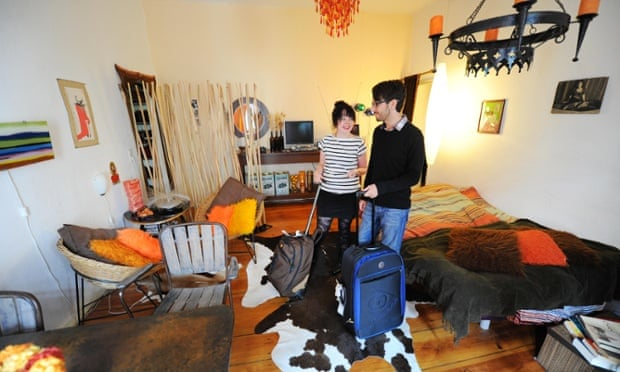 Home sweet home: a couple arrive in their Airbnb apartment.