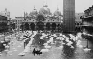 December 1933: Piazza San Marco, which sits at sea level, is quick to flood during acqua alta when water surges up through the drains in the square. In this case, snow-thawing created a flood in front of Saint Mark's basilica.