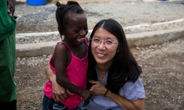 Joanne Liu hugs Ebola survivor Evelyn Sonpon.