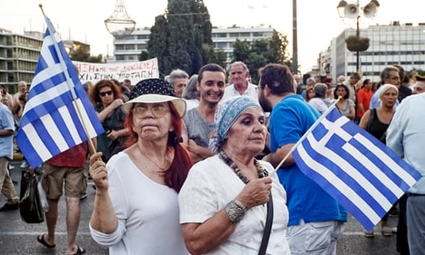 The strain shows on one protester's face at a pro-government rally in front of the Greek parliament in Athens as hopes fade of a breakthrough.