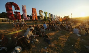 Festival goers enjoying the sun at Glastonbury.
