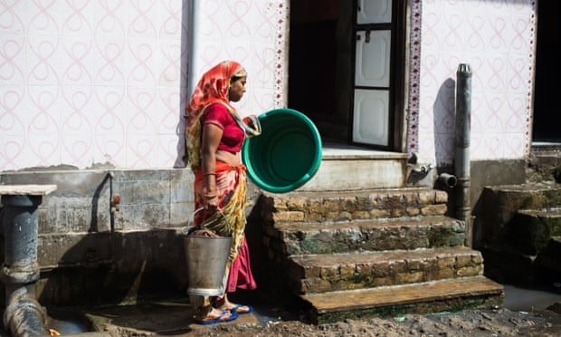 Indian maid with bucket