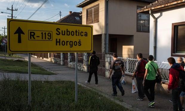 Migrants walk through Kanjiza, Serbia, northwards to Hungary.