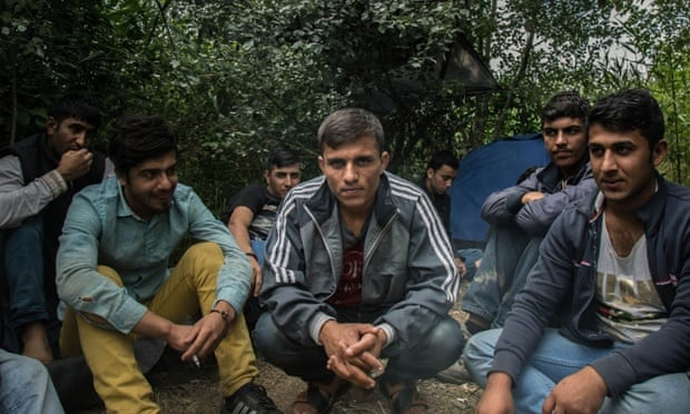 A group of Afghan migrants gather at a makeshift camp awaiting people smugglers or money to move northwards through Hungary.