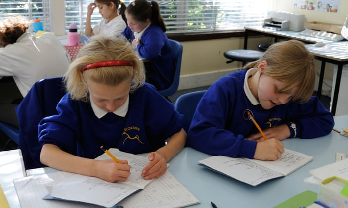 'Children are taught not to use simple words such as 'good', 'bad', 'small' or 'big' but to always find other more 'interesting' words to replace them' ... primary school children writing in a classroom. Photograph: Alamy