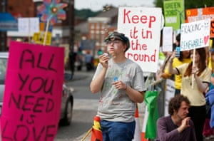 An anti-fracking protester blows bubbles during a demonstration outside County Hall in Preston, Britain June 24, 2015. Lancashire County Council is debating an application by shale gas firm Cuadrilla Resources to frack on the Fylde coast, local media reported.