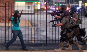 A man is arrested during protests over the death of Michael Brown, an unarmed black teenager killed by a police officer, in Ferguson, in August 2014.