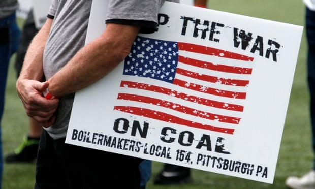 A member of the Boilermakers local 154 Pittsburgh holds a sign at a rally to support American energy and jobs in the coal and related industries at Highmark Stadium in downtown Pittsburgh, Wednesday, July 30, 2014. The rally is being held the day before the Environmental Protection Agency conducts public hearings on its new emissions regulations for existing coal fired power plants.