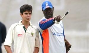 Arjun Tendulkar takes some advice from England bowling coach Ottis Gibson.