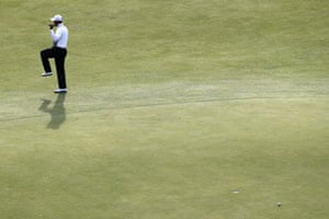 Tiger Woods reacts to missing a putt on the 18th green during the completion of his second round 75.