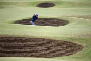 Amateur Paul Dunne of Ireland plays out of a bunker on the fifth hole.