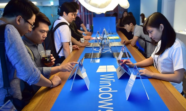Visitors try out Windows 10, the latest operating system from US software giant Microsoft, during a launch event in Seoul on July 29, 2015.