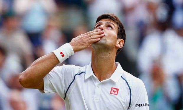 Novak Djokovic celebrates after winning his quarter final match against Marin Cilic.