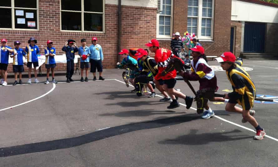 Students of West Ryde Primary School hold a jockey race to celebrate the upcoming Melbourne Cup, Sydney, Tuesday, Oct. 9, 2012. The trophy made its way to the school as part of a community tour ahead of the November 6 race. (AAP Image/Rashida Yosufzai) NO ARCHIVING