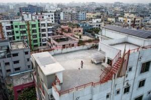 Dhaka, Bangladesh. Samin Sharar, 9, playing alone on the rooftop of his building