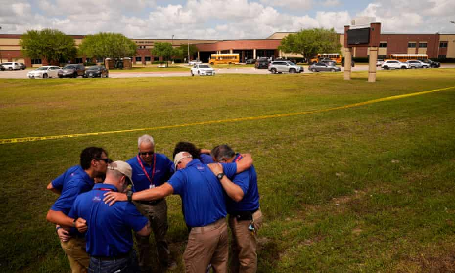 People gather to pray outside Santa Fe high school.