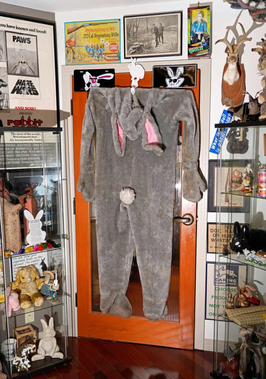 bunny costume hangs on a door among other souvenirs