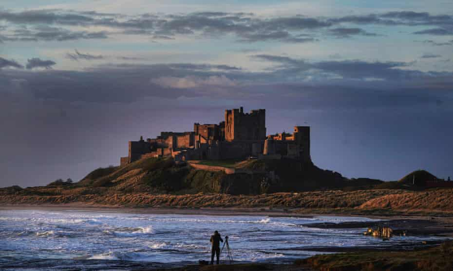 A photographer lines up his shot at Bamburgh Castle in Northumberland.