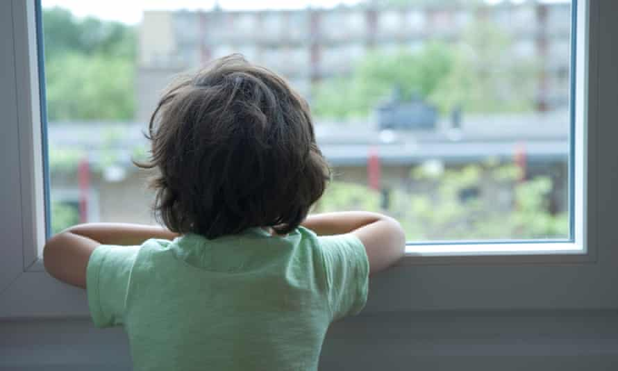 Sad boy looking out of window