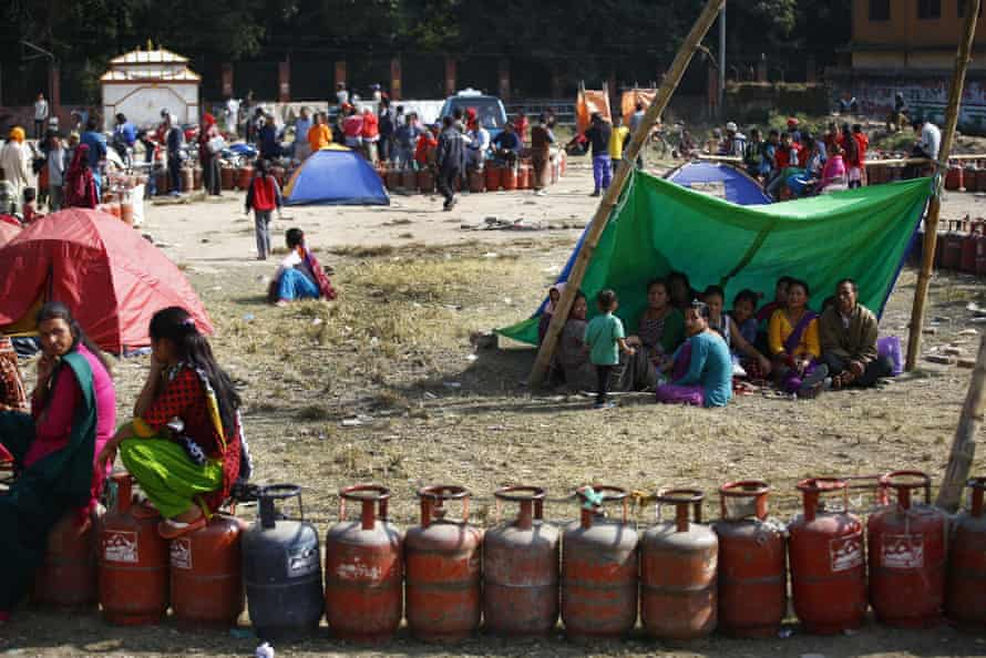 The effects of April's earthquake in Nepal are still felt as people queue for cooking gas cylinders in Kathmandu.