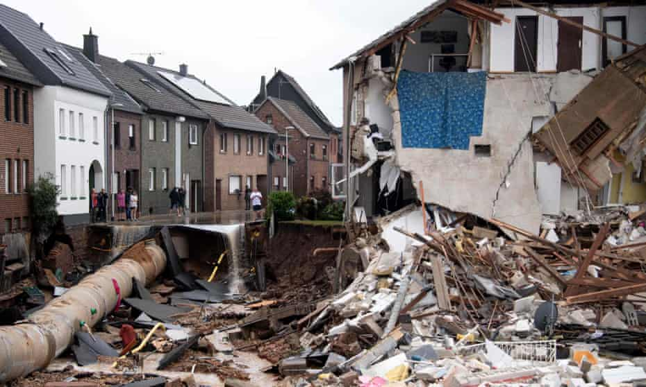 People stand in a devastated street in the Blessem district of Erftstadt