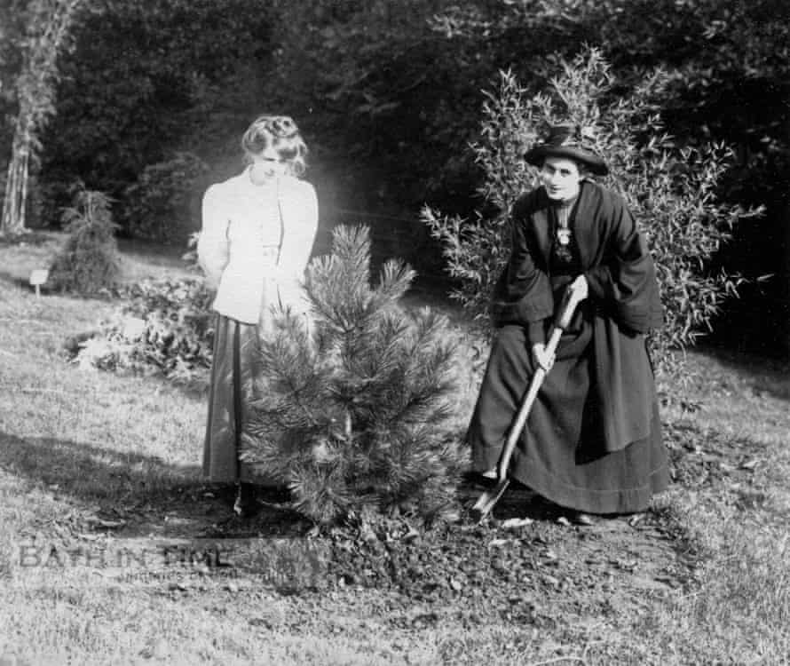 Suffragettes Rose Lamartine Yates and Annie Kenney plating the Batheaston pine in 1909. The picture is part of a unique collection of glass plate negatives taken by Col Linley Blathwayt of Eagle House, Batheaston, a refuge for suffragettes between 1908 and 1912.