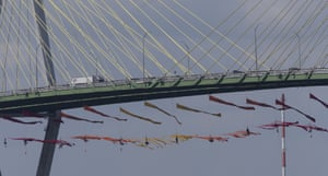 Greenpeace USA protesters dangle from the Fred Hartman Bridge about the Houston Ship Channel in Texas yesterday