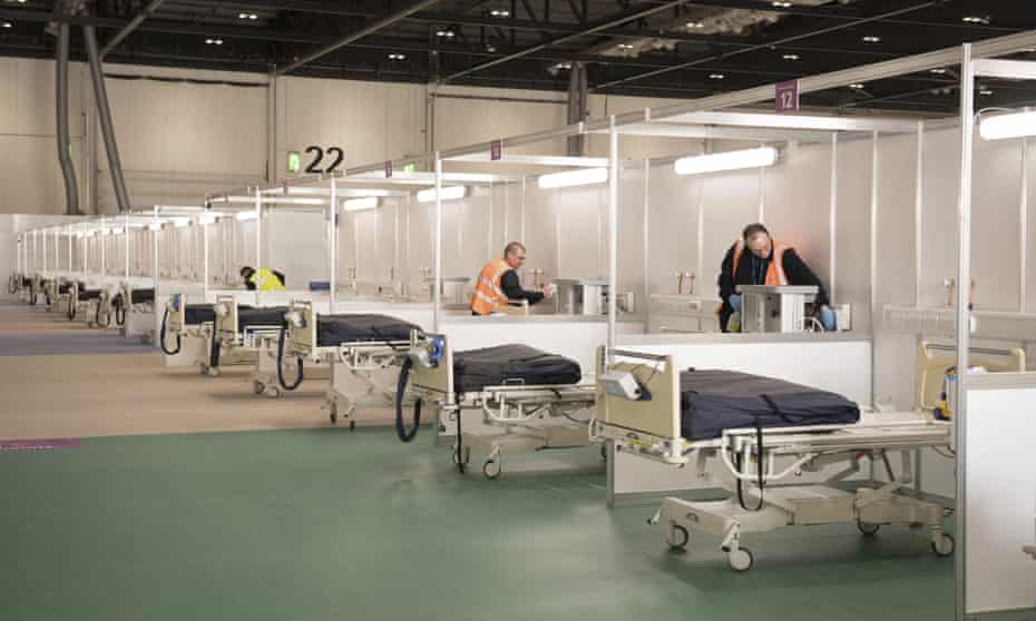 Contractors transform the ExCel centre in east London into the NHS Nightingale hospital in late March.