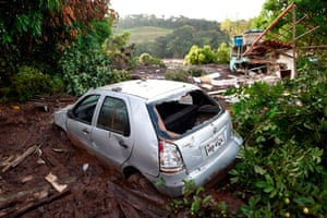 The wreckage of a car and a house are seen a day after the collapse of a dam at a mine belonging to Brazil's giant mining company Vale.