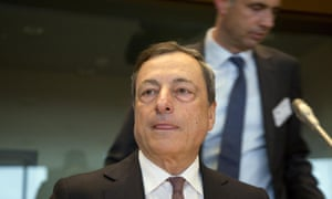 European Central Bank Governor Mario Draghi, center, listens during a meeting of the Economic and Monetary Affairs Committee at the European Parliament in Brussels on Monday, June 15, 2015. (AP Photo/Virginia Mayo)