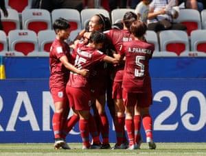 Thailand's Kanjana Sung-Ngoen celebrates with her team-mates.