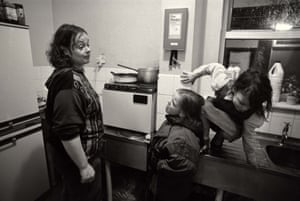 Mandy (mother) with L-R Emma and Donna in the kichen at the hostel for homeless families, Blackpool, 1992