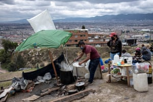 Some of the evicted inhabitants, about 60 people, set up a makeshift camp on a nearby sports field at La Ville Nue / The Bare CityBogotá on 15 May.