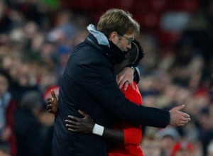 Sadio Mané gets an appreciative hug from manager Jürgen Klopp as he is substituted.