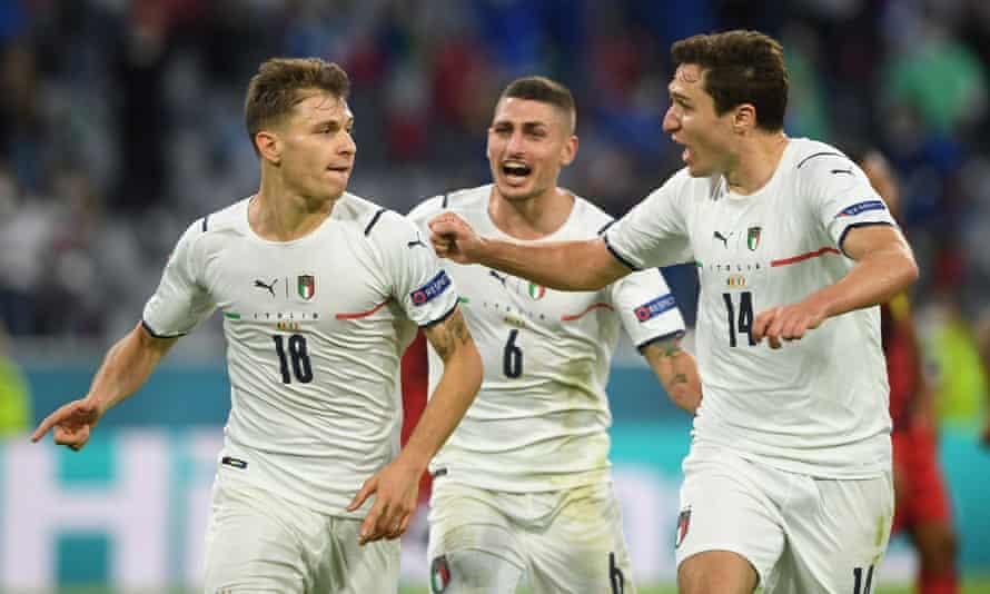 Italy's Nicolò Barella celebrates scoring their first goal against Belgium with Federico Chiesa and Marco Verratti