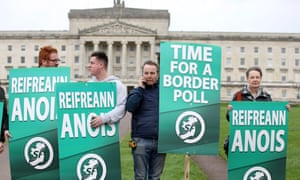 Sinn Féin activists protest at Stormont in Belfast, calling for a border poll on Irish reunification.