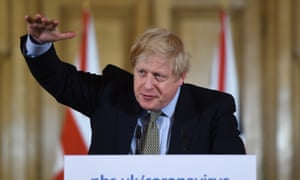 Boris Johnson gestures during a news conference regarding the coronavirus, in Downing Street.