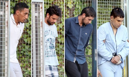 Driss Oukabir, Mohammed Aallaa, Salah el Karib and Mohamed Houli Chemlal are taken to Spain's national court in Madrid on Tuesday.