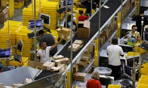 Workers sort arriving products at an Amazon fulfilment Centre.